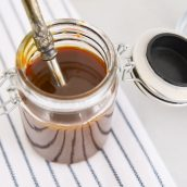 overhead close up of caramel sauce in glass jar