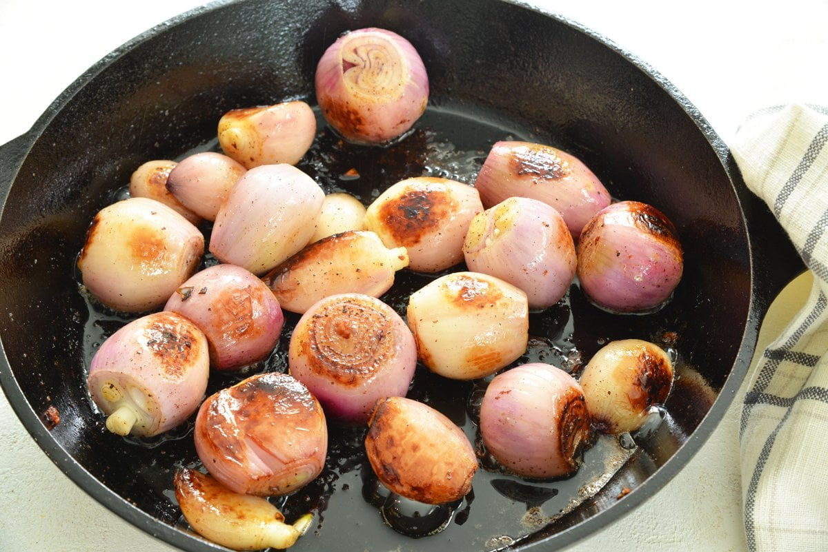 caramelized shallots in a cast iron skillet