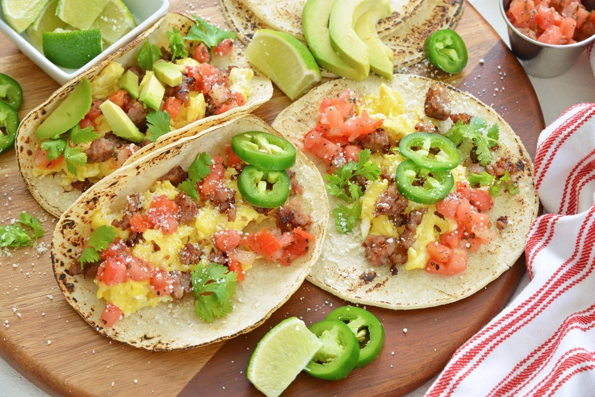 breakfast tacos ready to be served with lime wedges