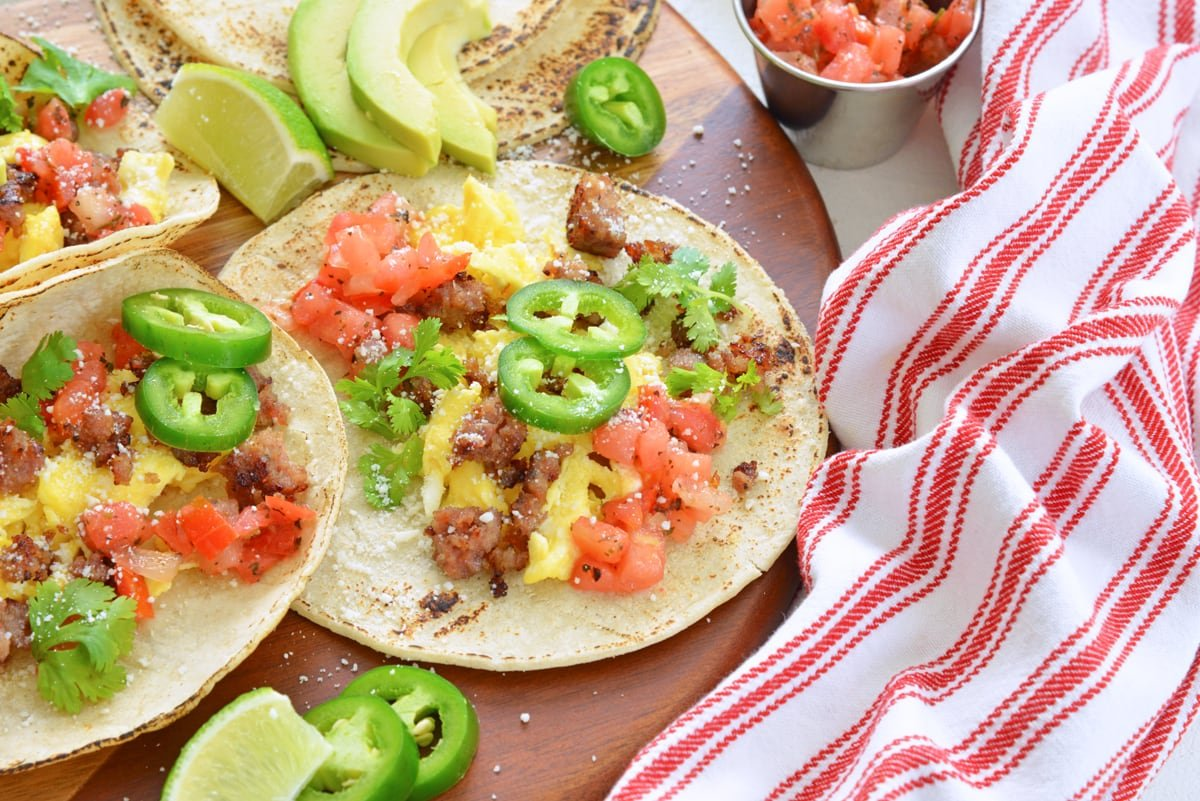 angle view of corn tortilla with eggs, sausage, pico and jalapeno