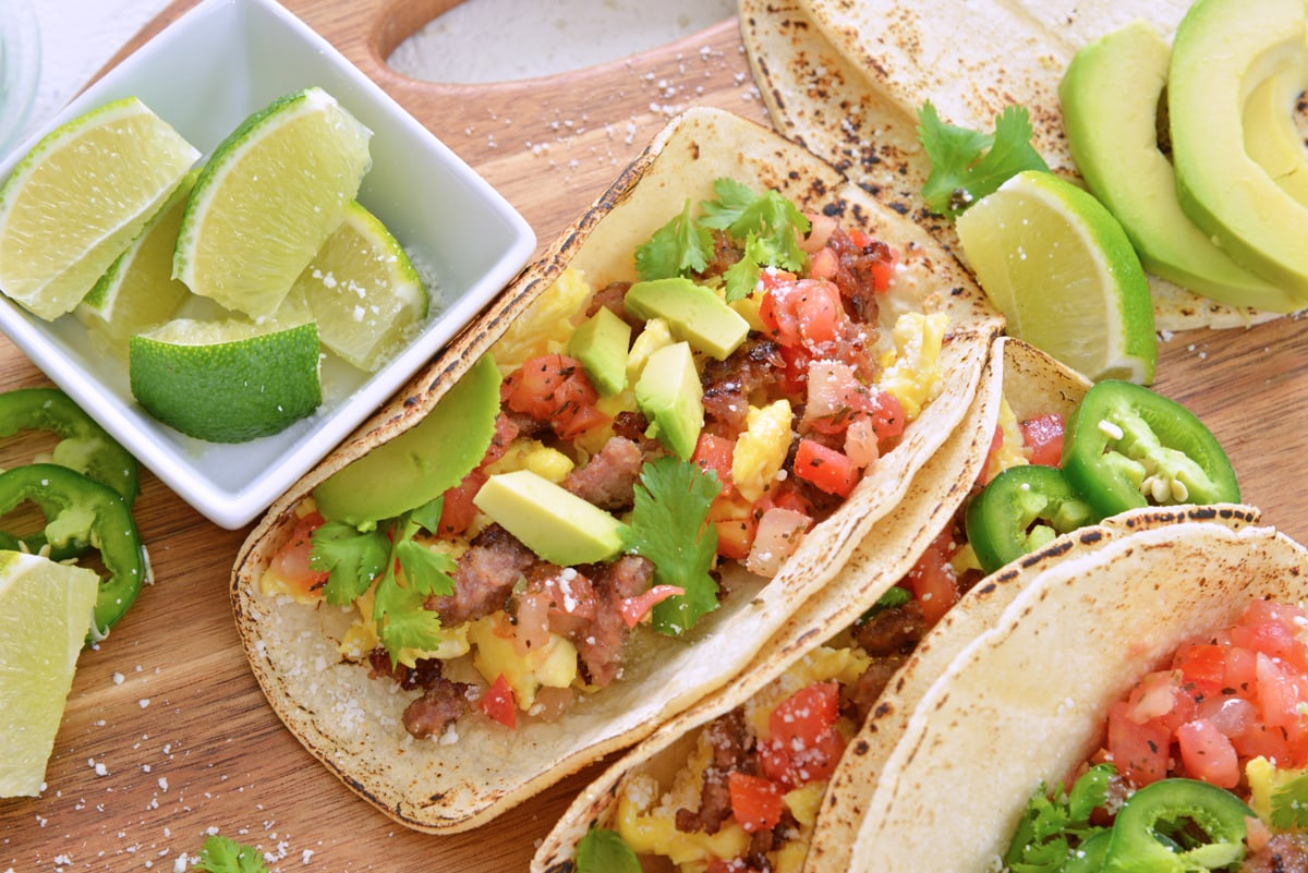 close up of a breakfast taco with avocado