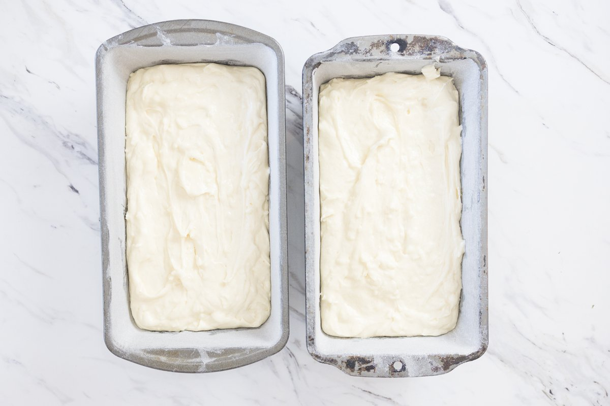 coconut pound cake batter in two loaf pans