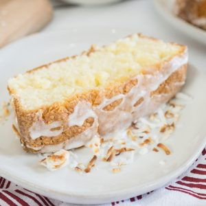 close up slice of coconut cream pound cake with drizzle