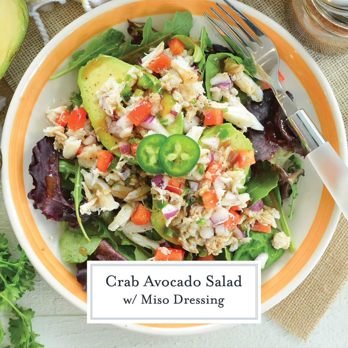 close up overhead of crab avocado salad with jalapeno slices