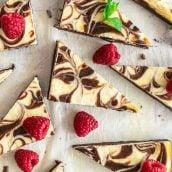 cut cream cheese brownies with fresh raspberries
