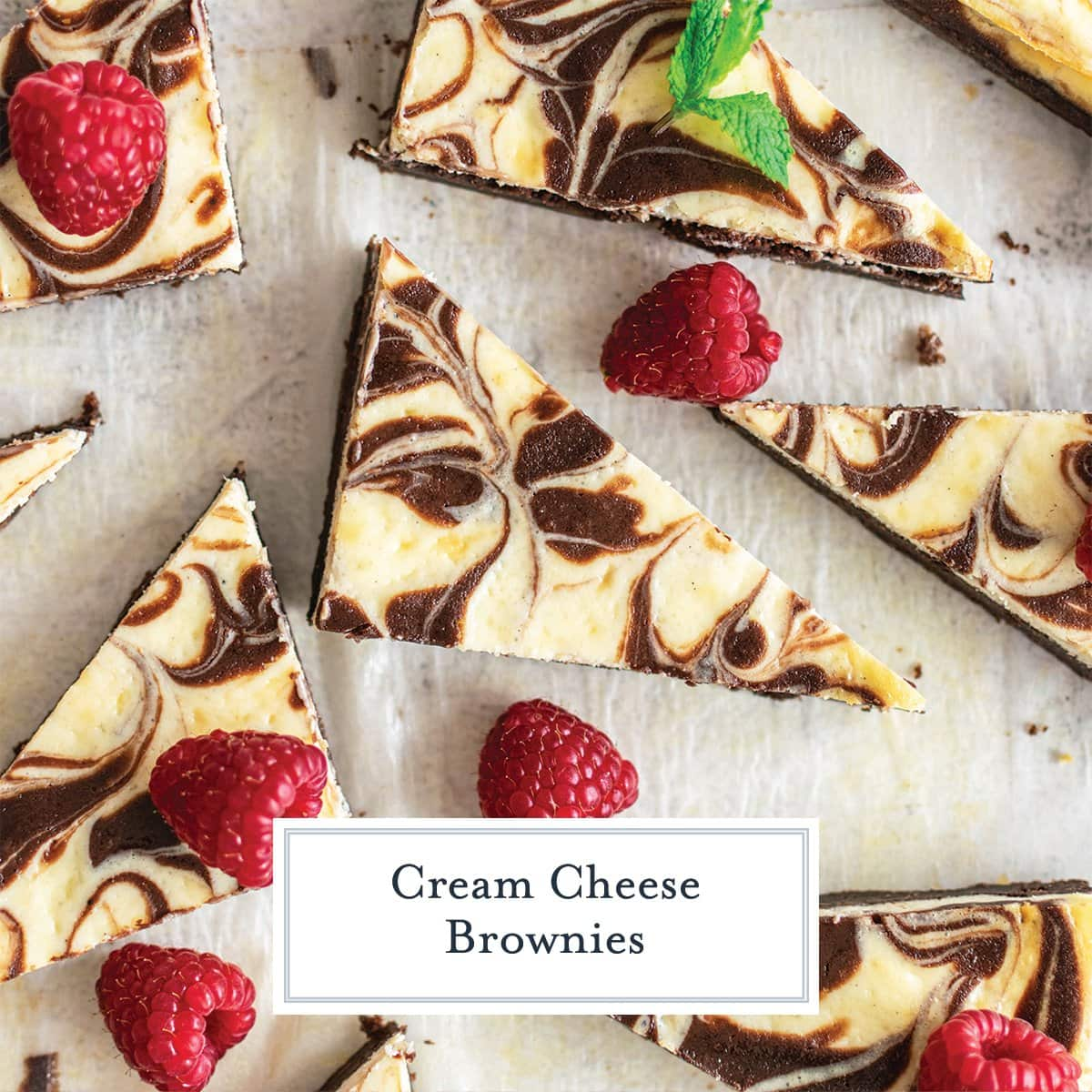 close up of swirl cream cheese brownies cut into triangles