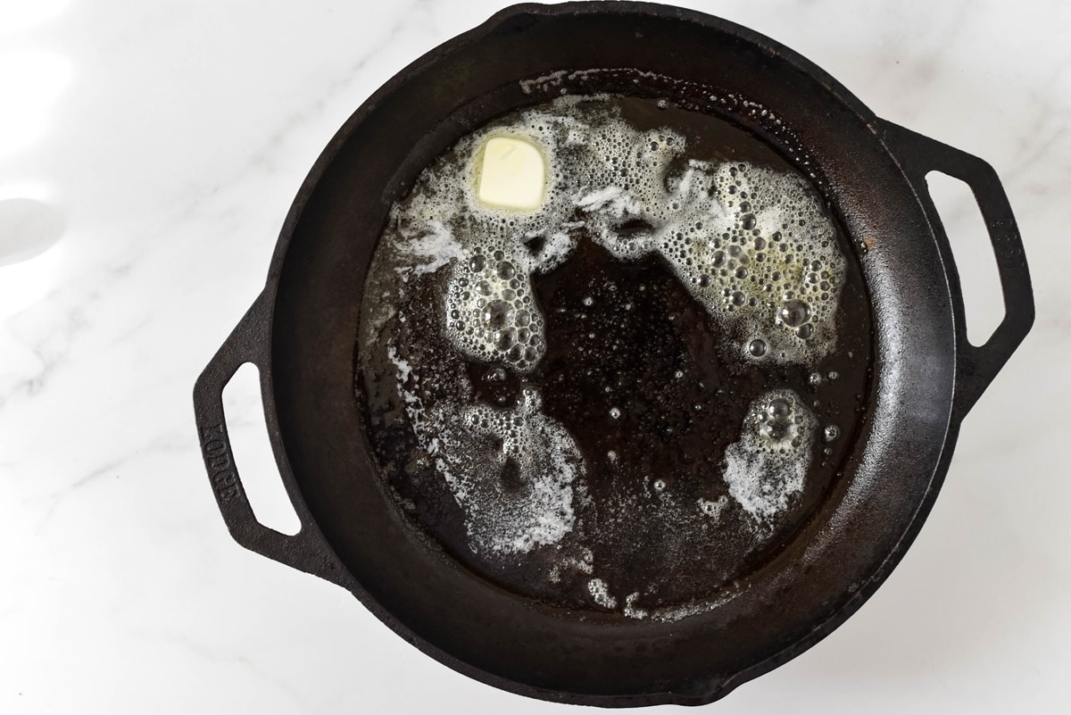 melted butter in a cast iron pan
