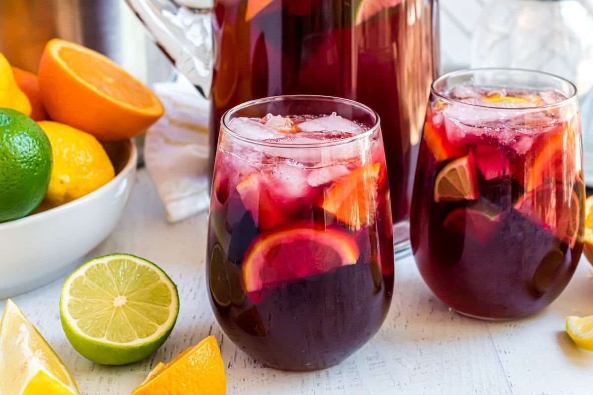 side view of red wine sangria with fruit