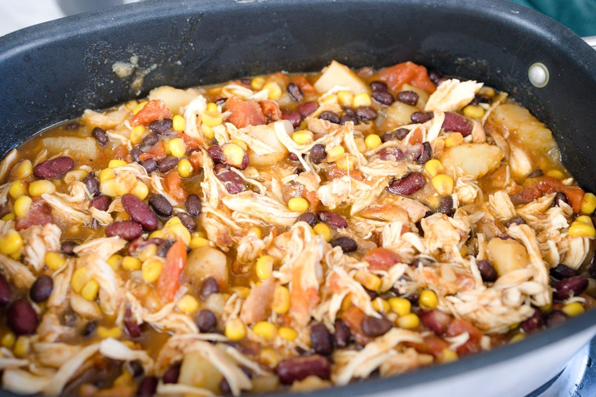 angle view of shredded chicken in a crockpot