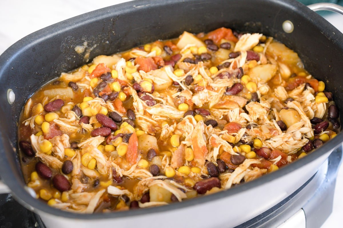 close up of chicken, corn and beans in a slow cooker