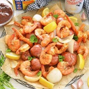platter of steamed shrimp with beer and old bay