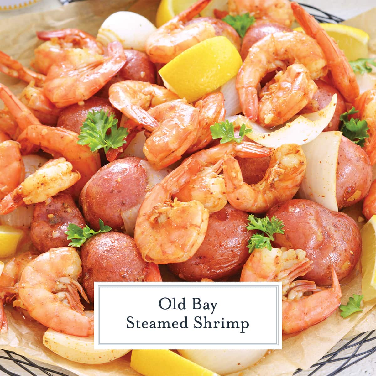 close up of steamed shrimp with lemons and onions and potatoes