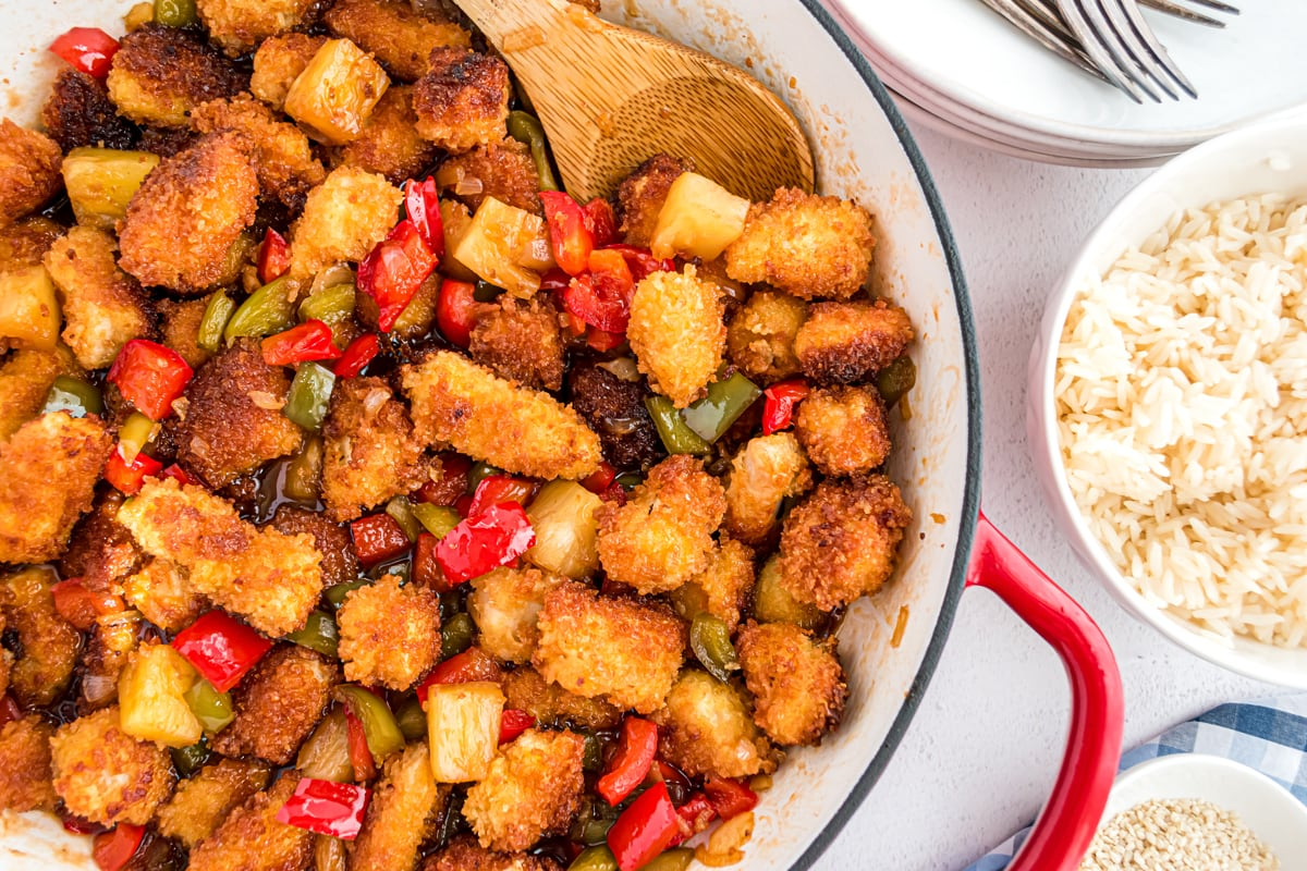 crunchy chicken in sweet and sour sauce in a skillet