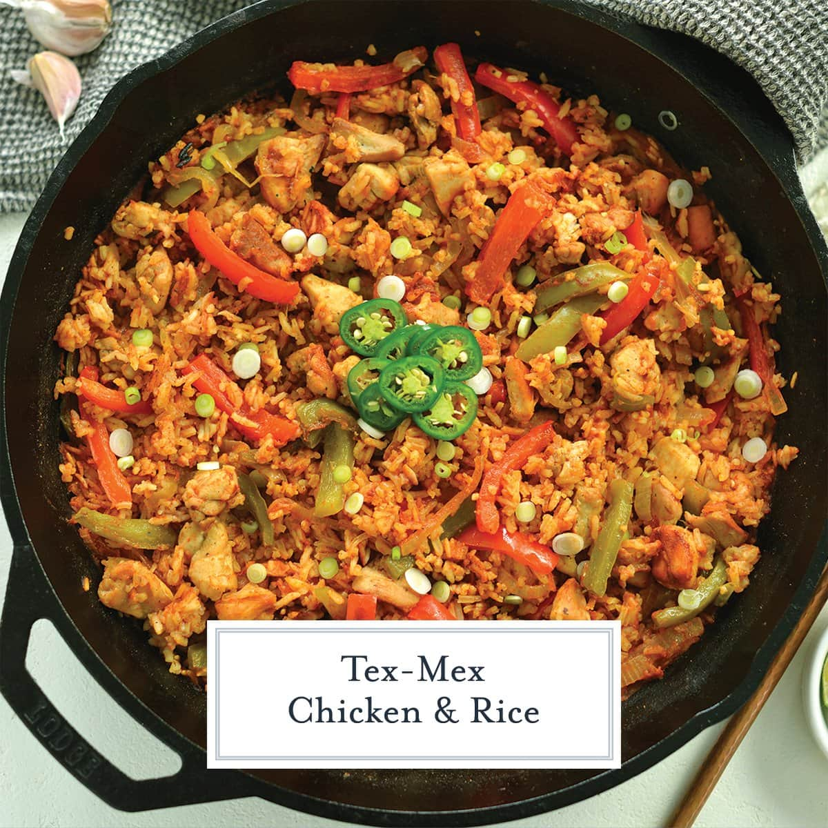overhead of chicken and rice skillet with jalapeno slices
