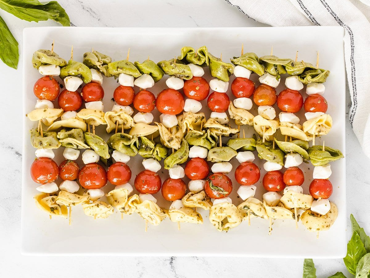 overhead platter of cold tortellini salad skewers