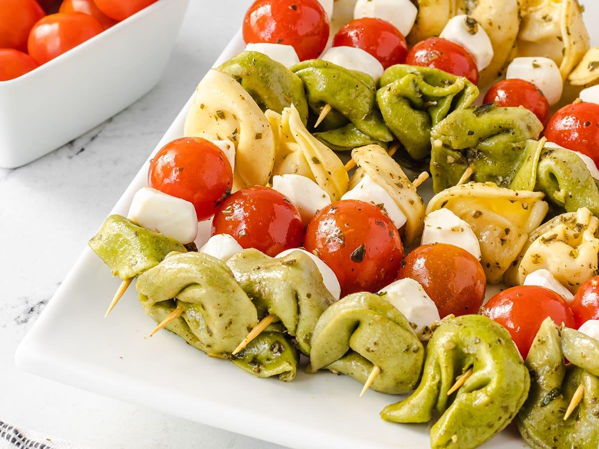 close up of tortellini salad on a stick