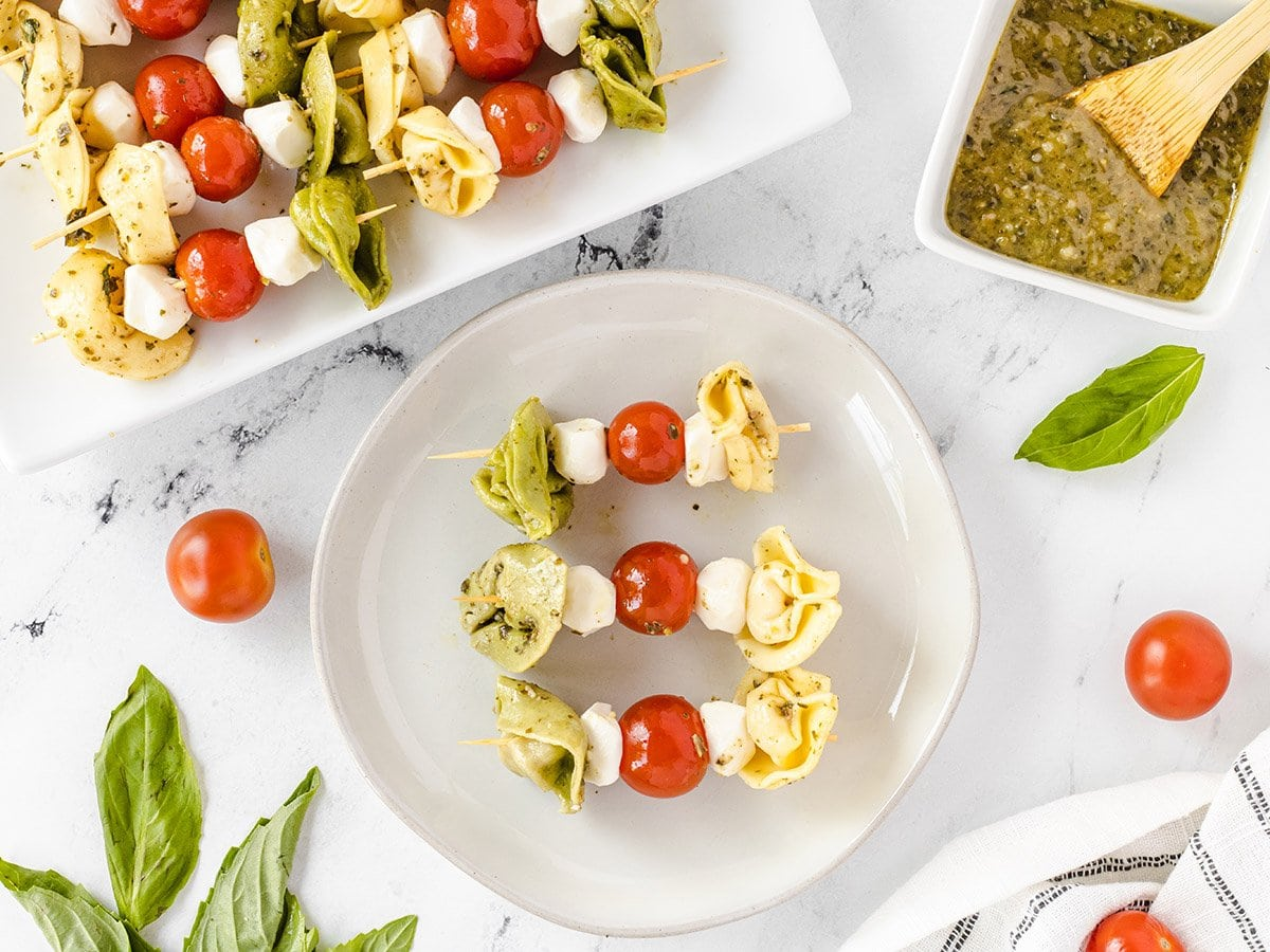 overhead of tortellini kabobs on a plate