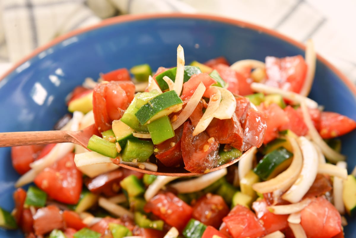 spoon of cucumber tomato salad