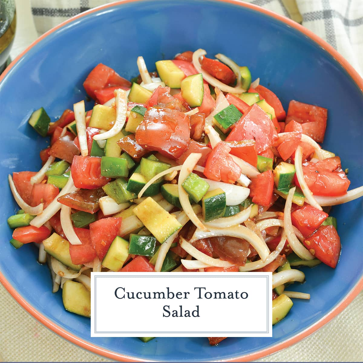 close up of tomato salad with dressing in a blue bowl