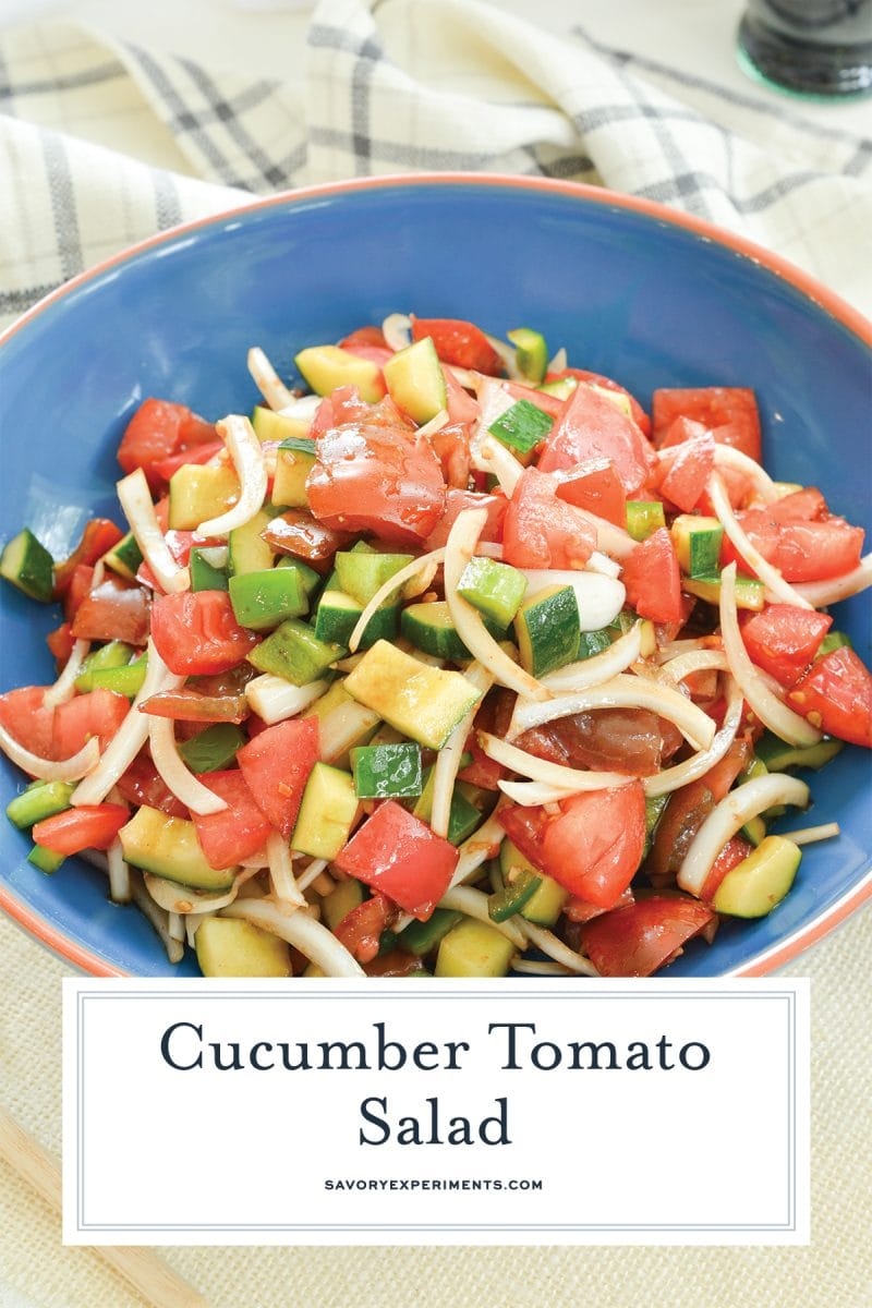close up of cucumber tomato salad in a blue bowl