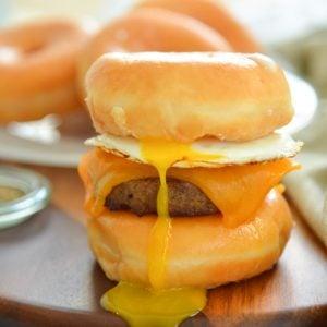 donut breakfast sandwich with drippy egg yolk