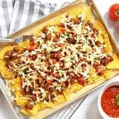 overhead of italian nachos on a sheet pan