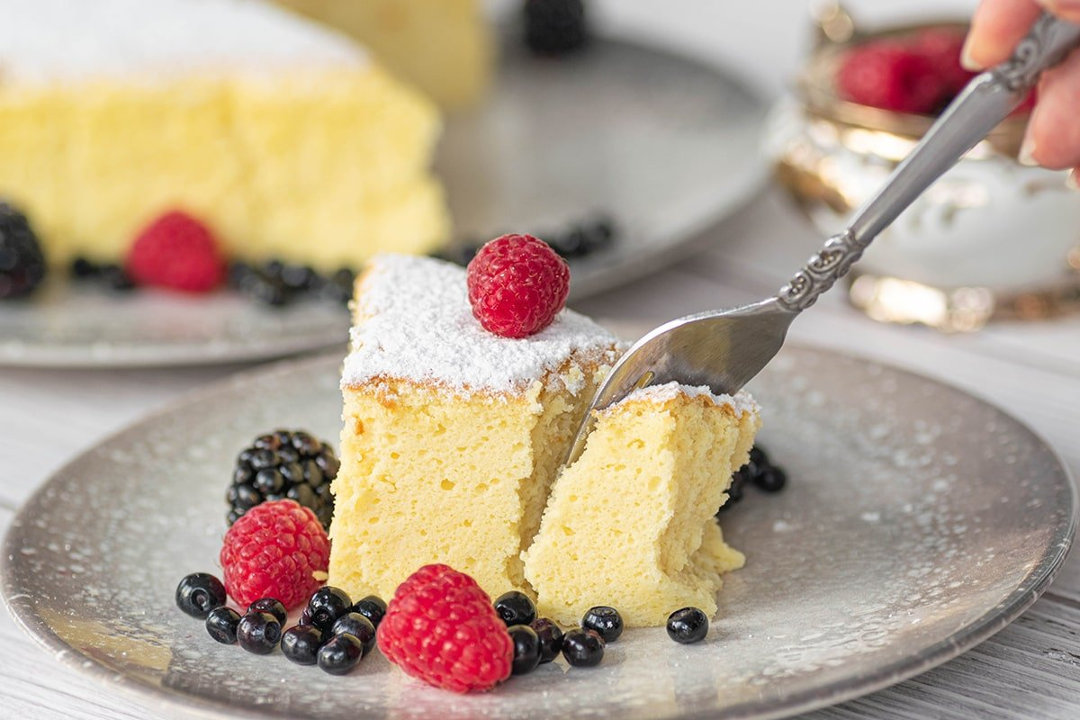 fork digging into slice of cheesecake