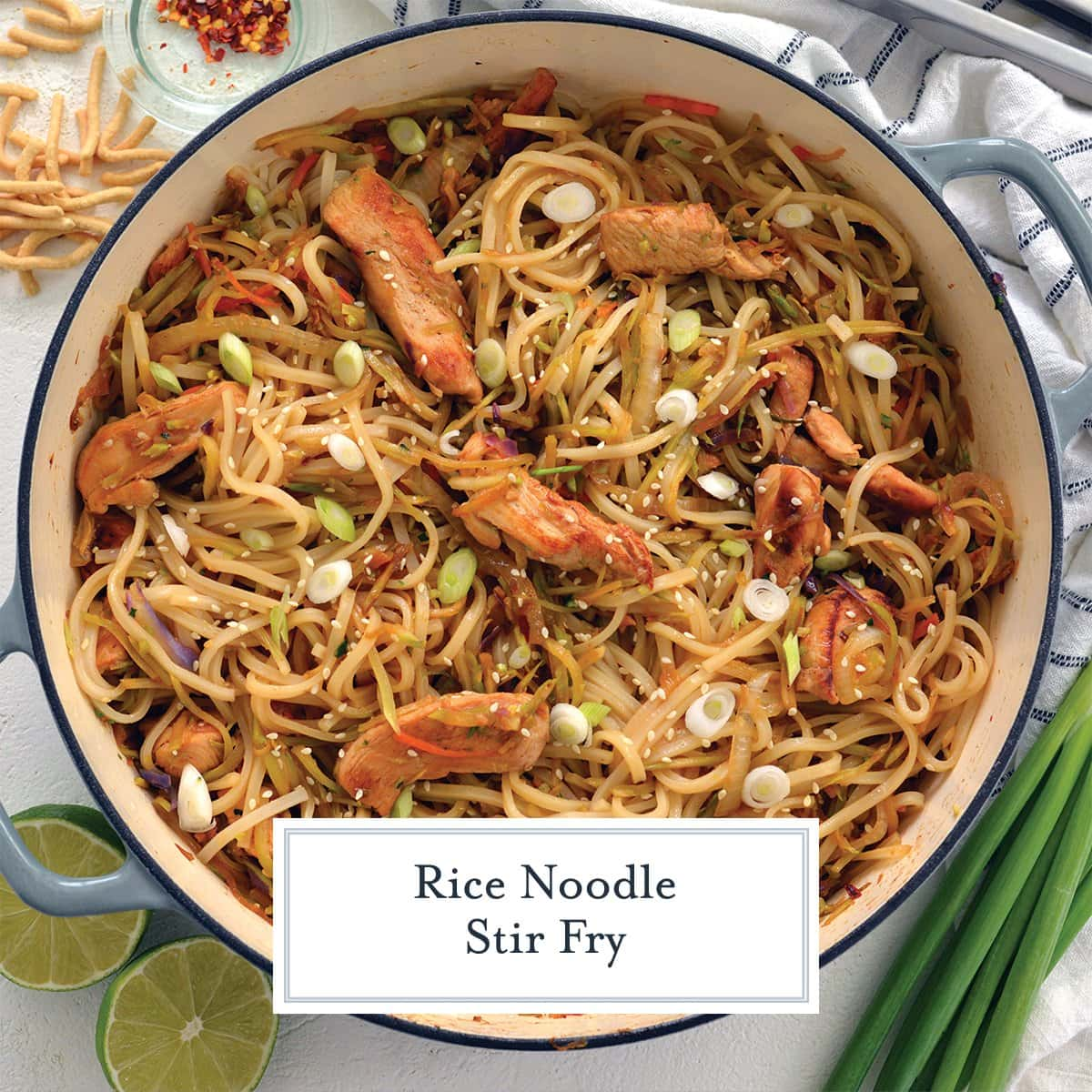 overhead of rice noodle stir fry in a blue cooking vessel