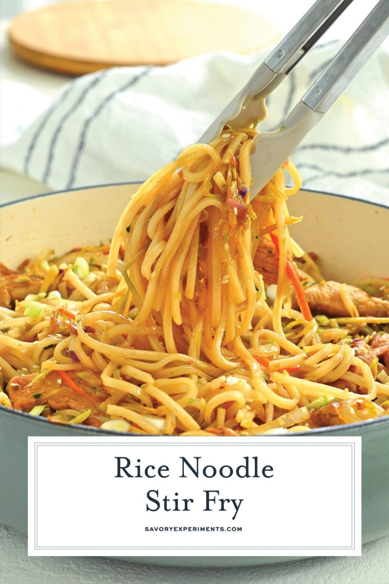 tongs picking up stir fry noodles