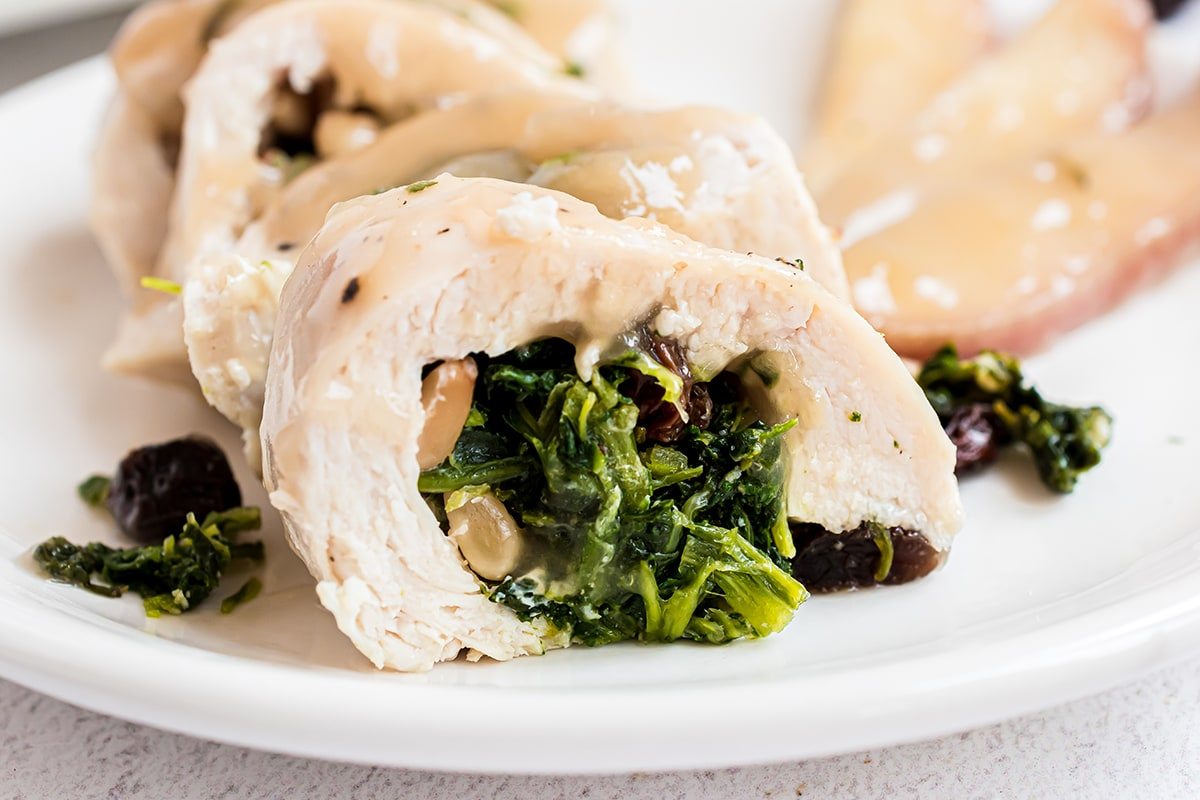 close up of spinach stuffed chicken roll