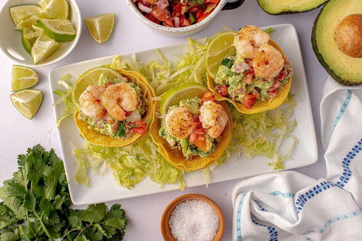 shrimp tostada appetizer on a white serving plate