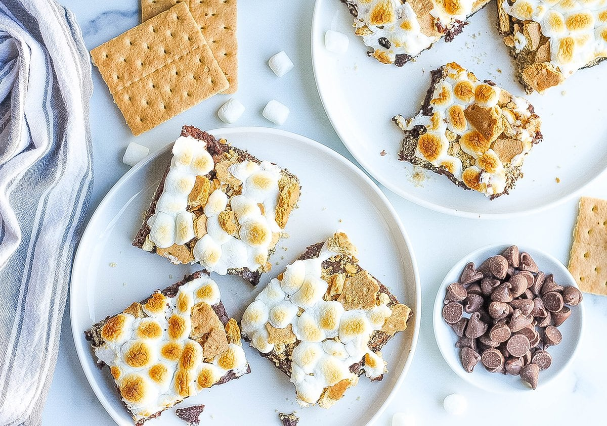 overhead of s'mores brownies being served on white plates