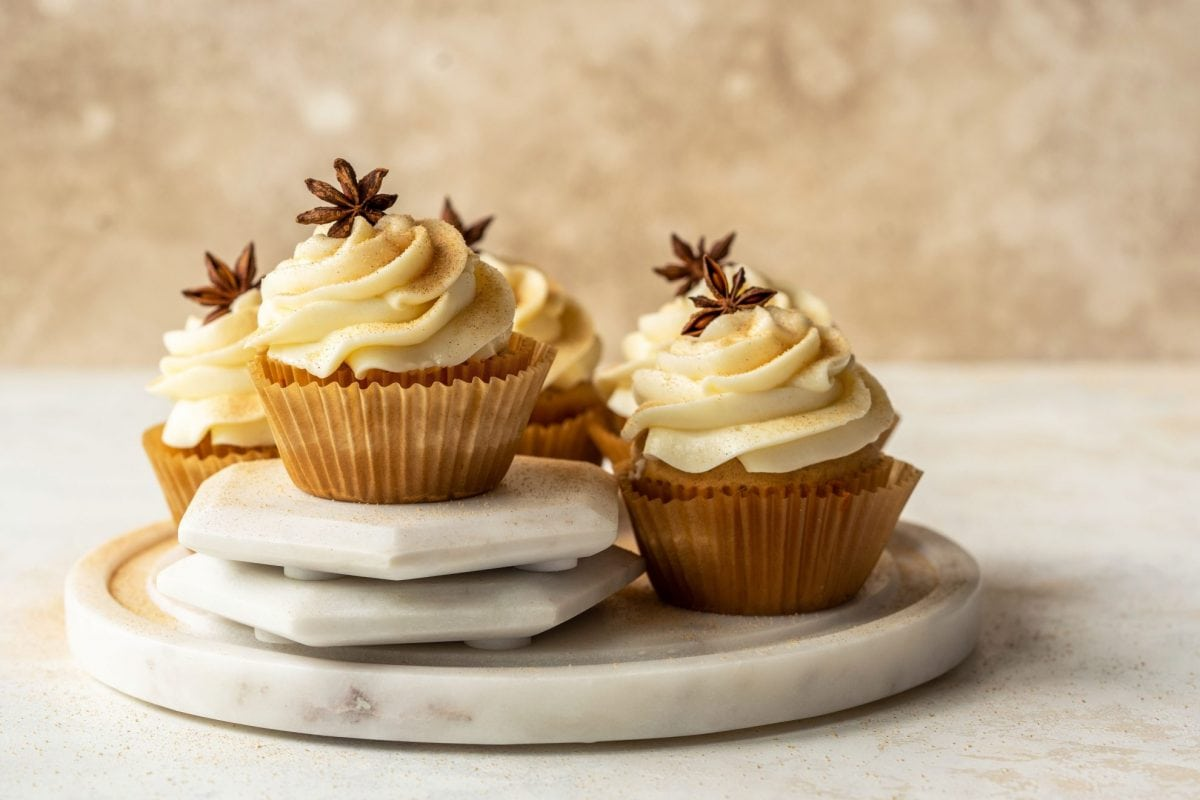 cupcakes decorated with frosting and star anise