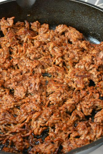 cast iron of browned ground beef