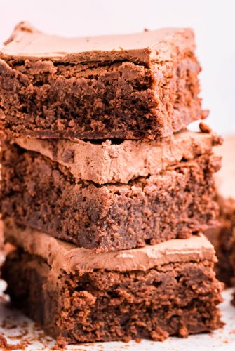 stack of frosted brownies