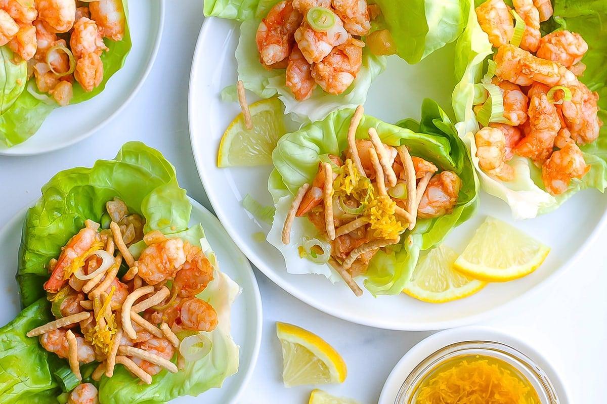 serving ginger shrimp lettuce wraps with toppings
