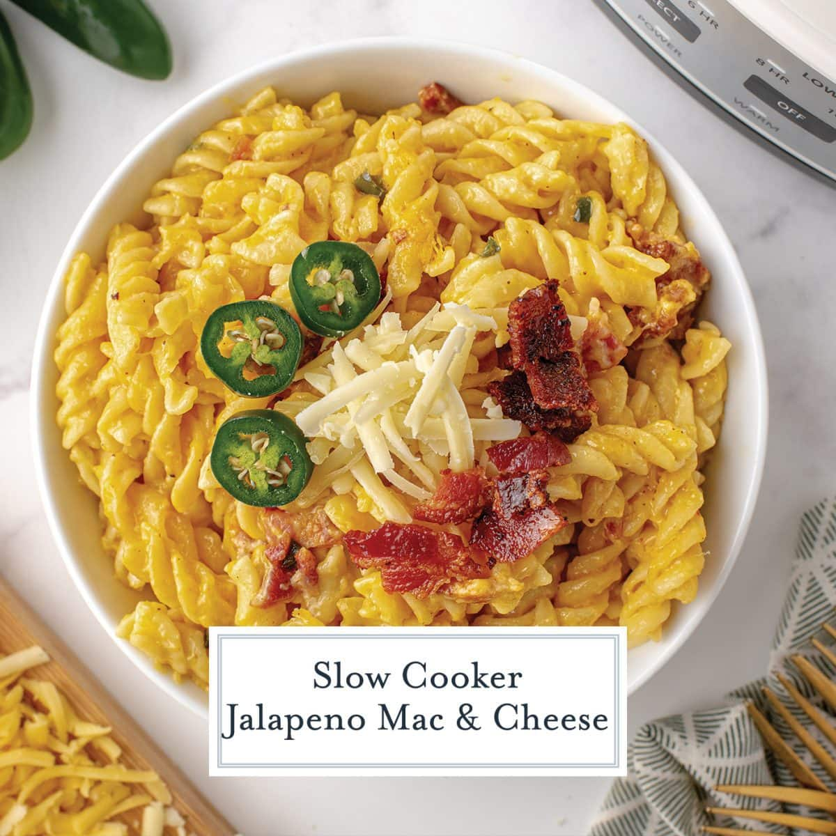 overhead close up of jalapeno mac and cheese in a bowl with jalapeno slices, cheese and bacon