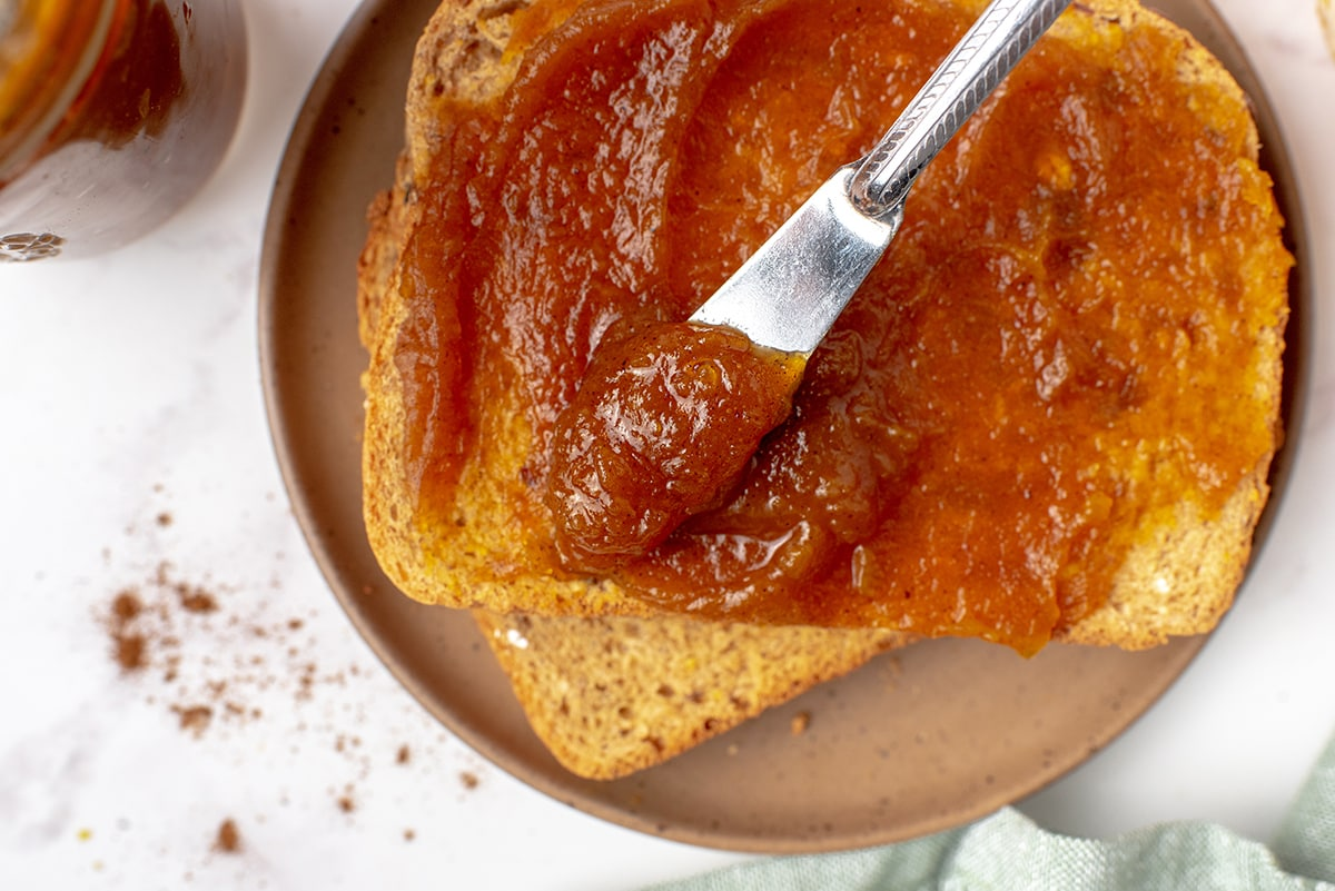 knife spreading butter on toast