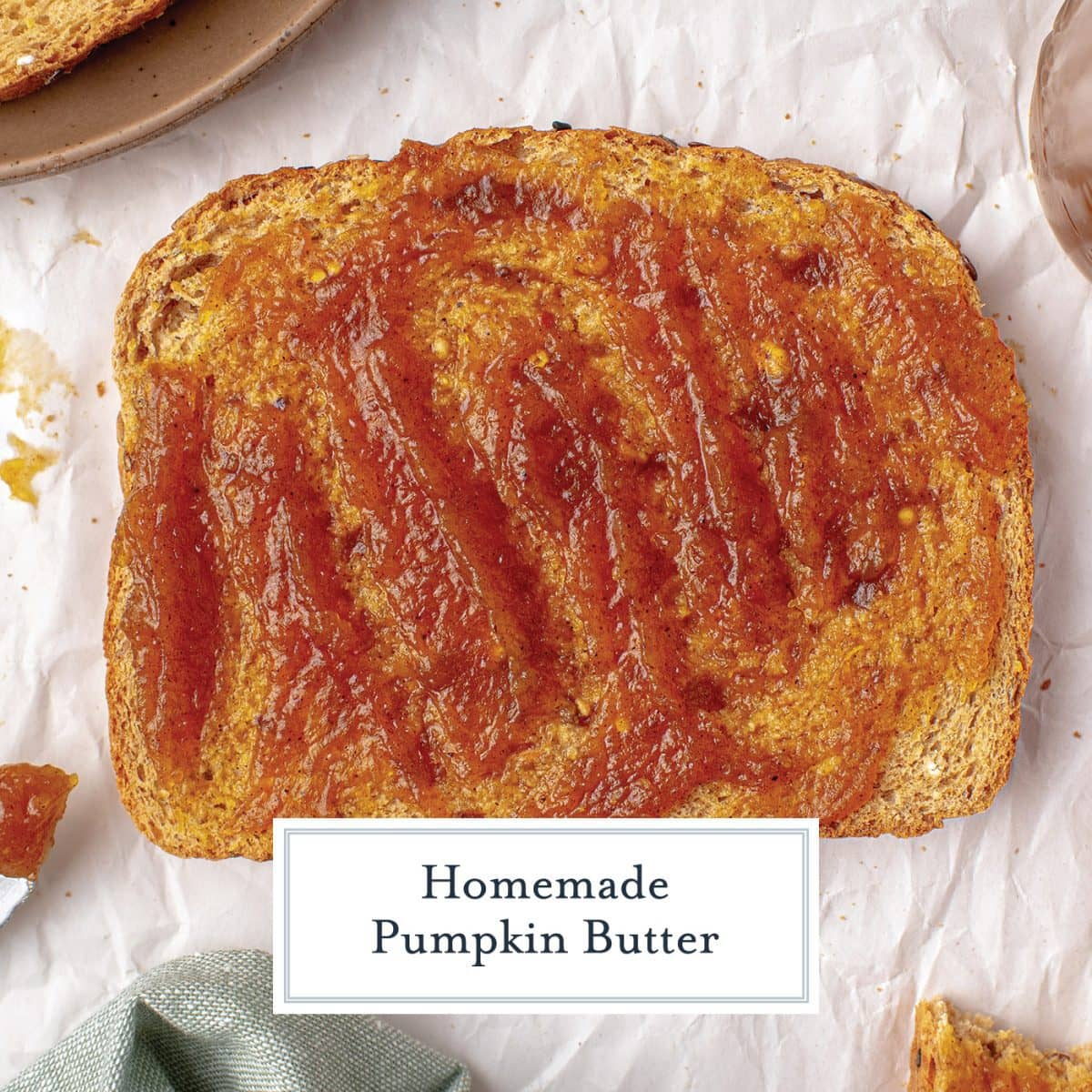 close up of pumpkin butter slathered onto a slice of toast