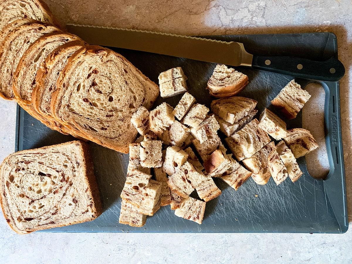 sliced cinnamon swirl bread on a cutting board