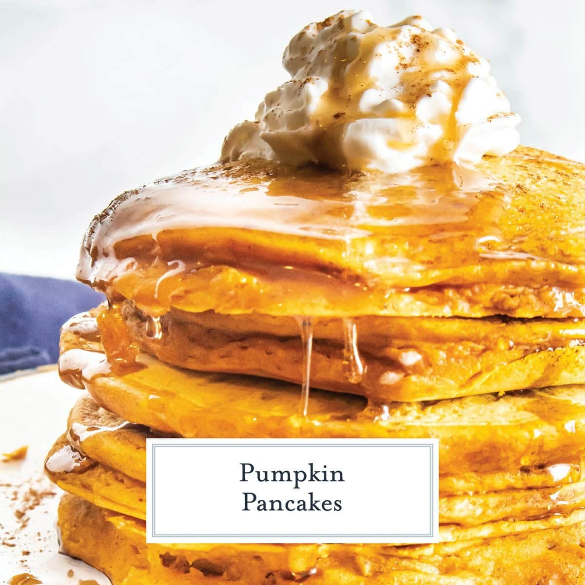 side angle view of pumpkin pancakes dripping with syrup