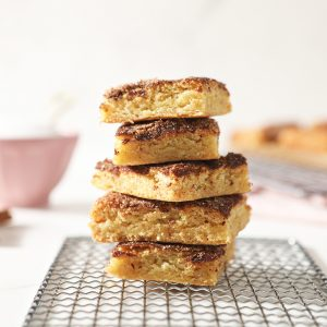 stack of snickerdoodle bars on a cooling rack