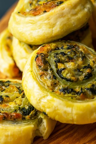 close up of spinach puff pastry pinwheels